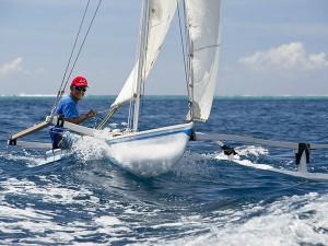 Tahitian style outrigger sailing canoe © Julien Girardot